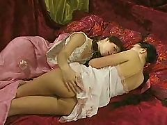 Young Russian lesbians use a strap on to fuck each other's pussy