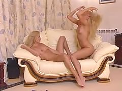 Two blonde lesbians acting up at posh sofa