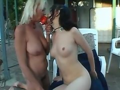 Mature lesbian dildoing young pussy